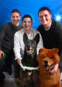 Photo of 3 boys and 2 dogs
