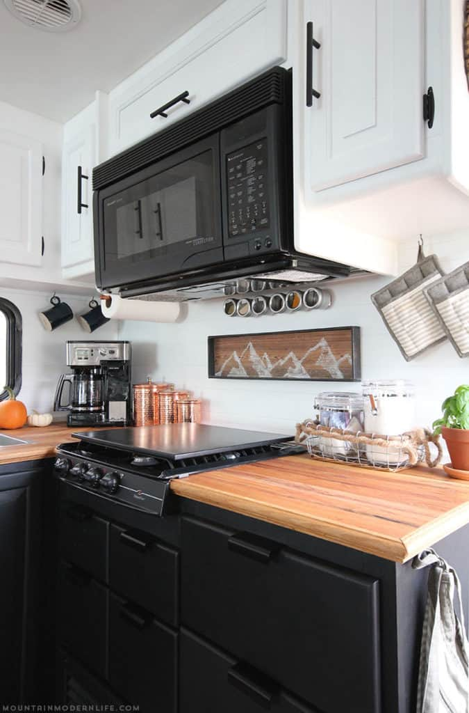Check out this cozy farmhouse kitchen remodel by Mountain Modern Life! Read about several options to upgrade your RV kitchen during your RV renovation.