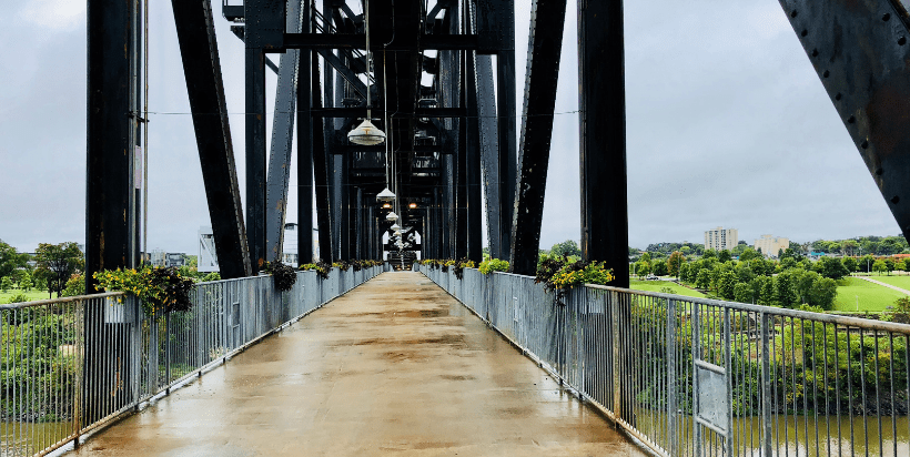 The former Rock Island Railroad Bridge, built in 1899, was renovated into a ramped pedestrian pathway that ends at the Clinton Presidential Library.