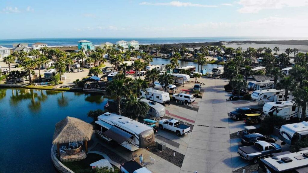Gulf Waters Beachfront RV Resort is located on Mustang Island beach in Port Aransas, Texas, which is right on the Gulf Coast. In addition to boardwalk access to the beach, the resort itself is beautifully landscaped palm trees beside and ponds. Walk to the beach right from your RV!
